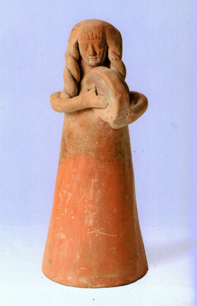 A clay figurine, playing the tambourine.